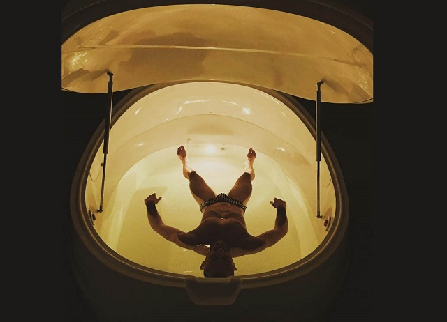 man inside float tank