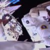 Spacewalking space explorers near fixing vast beam finder