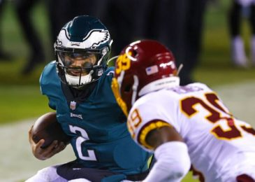 Philadelphia Eagles' QB Jalen Hurts scores two rushing TDs in first half against Washington